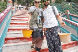 Helping bring supplies up the stairs for construction in the Batu Caves