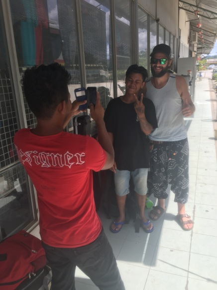 The locals at this bus stop wanted to take photos with us. We took some photos and then had a beer!